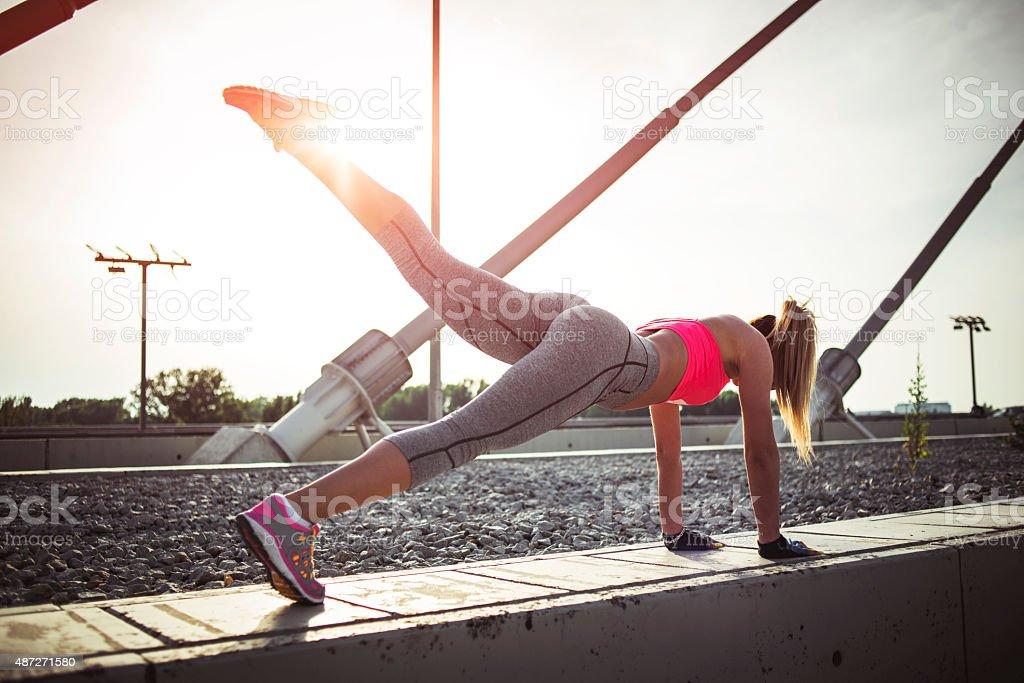 Woman doing pushups stock photo