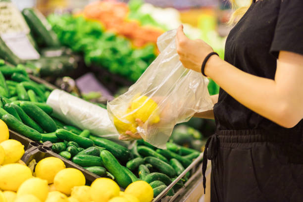 woman doing shopping with plastic bag woman doing shopping with plastic bag plastic bag stock pictures, royalty-free photos & images