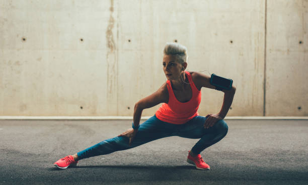 woman doing side lunges - lunge stock photos and pictures