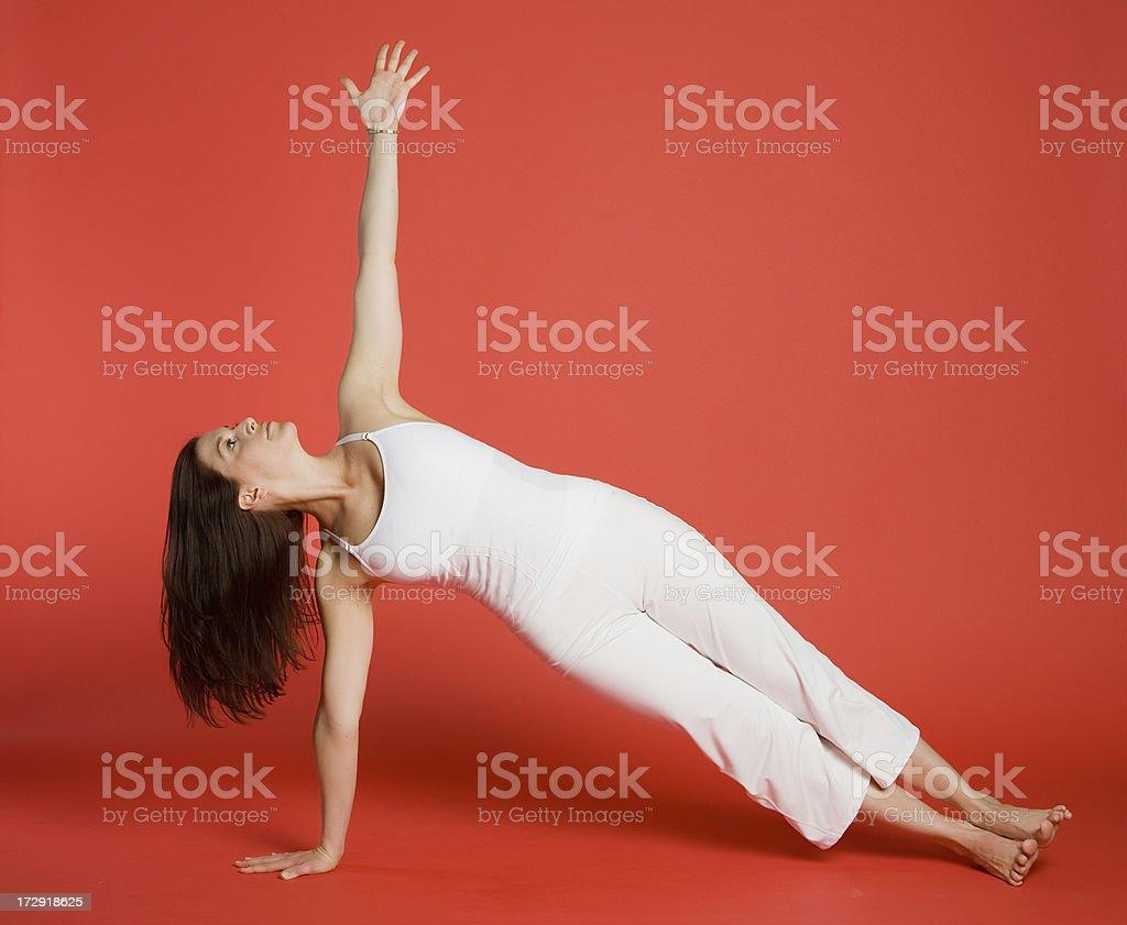 Woman doing side staff yoga pose royalty-free stock photo