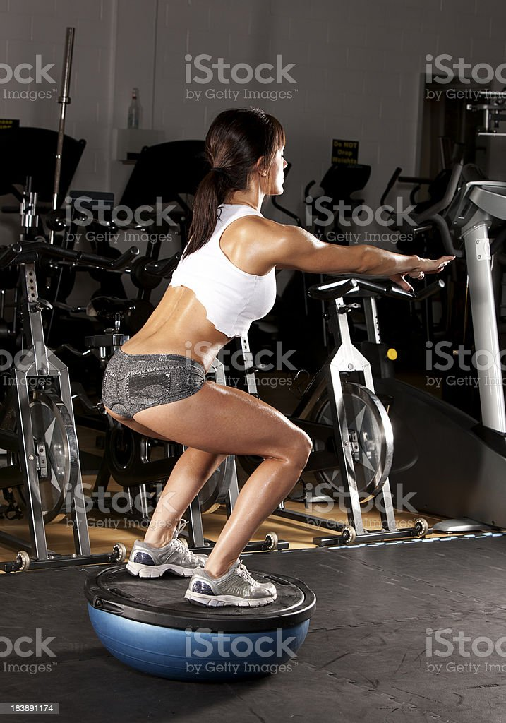 Woman Doing Squats royalty-free stock photo