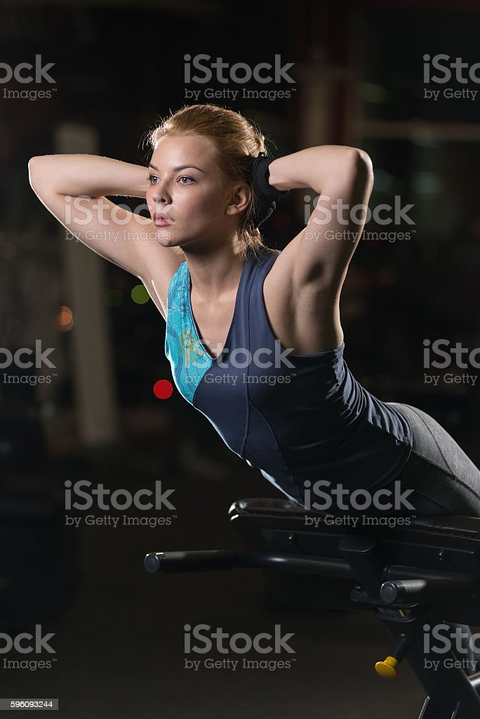 Woman doing strength exercises for abs muscles royalty-free stock photo