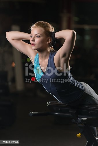Woman Doing Strength Exercises For Abs Muscles Stock Photo & More Pictures of Abdominal Muscle