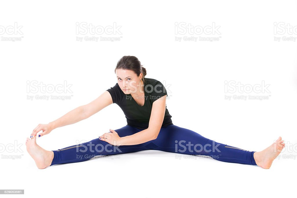 Woman doing stretches stock photo