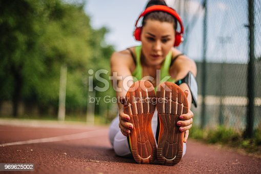 520047182istockphoto Woman doing stretching exercises 969625002