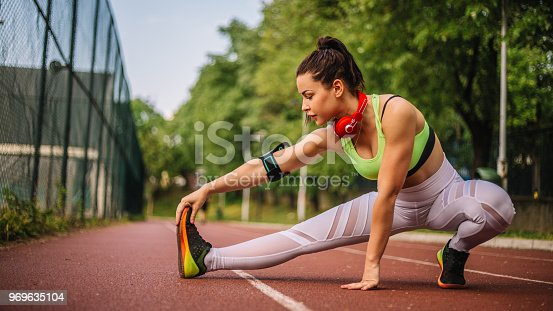 520047182istockphoto Woman doing stretching exercises 969635104