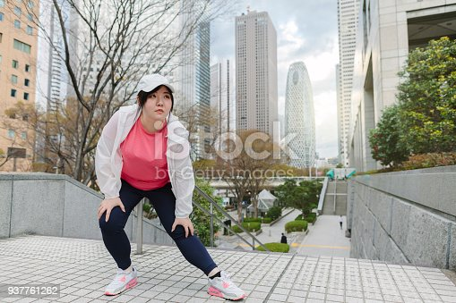851958232 istock photo Woman doing stretching in city 937761262