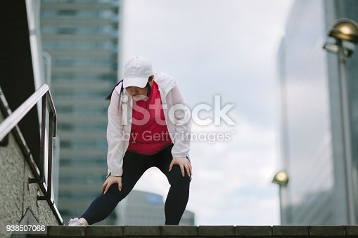 851958232 istock photo Woman doing stretching in city 938507066