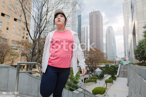 851958232 istock photo Woman doing stretching in city 951162750