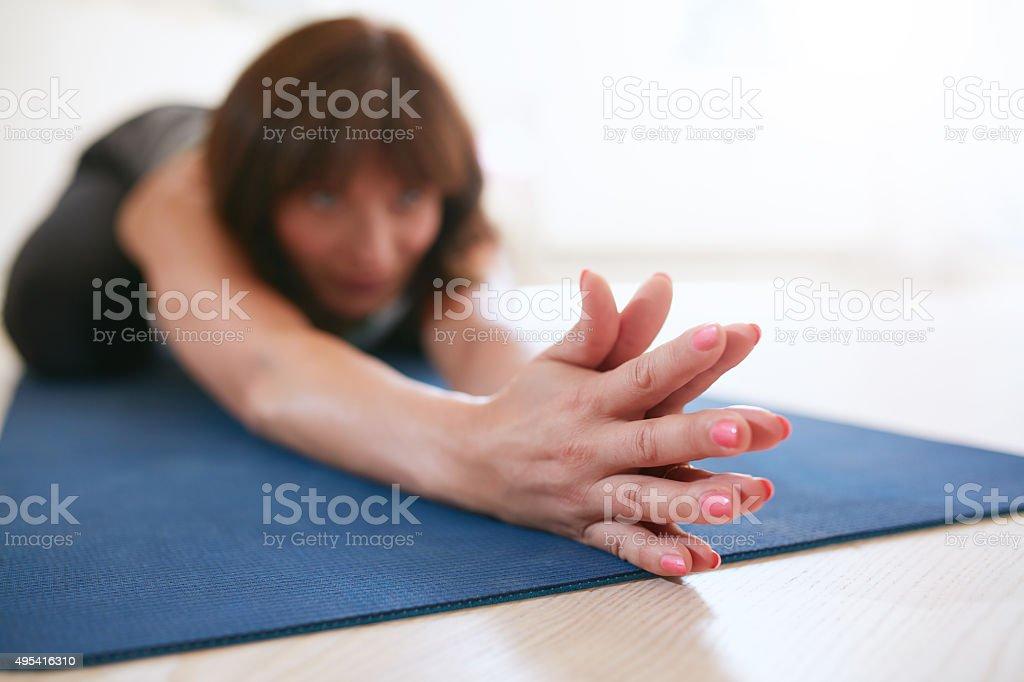 Woman Doing Stretching Workout On Yoga Mat Stock Photo