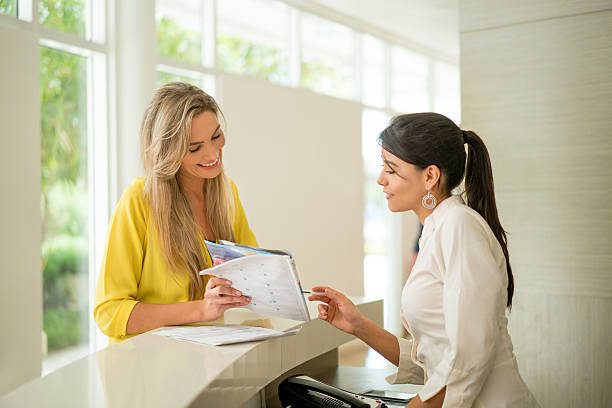 Woman doing the check-in at the hotel stock photo