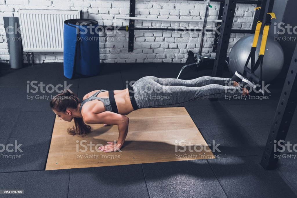 woman doing TRX Suspension Training royalty-free stock photo