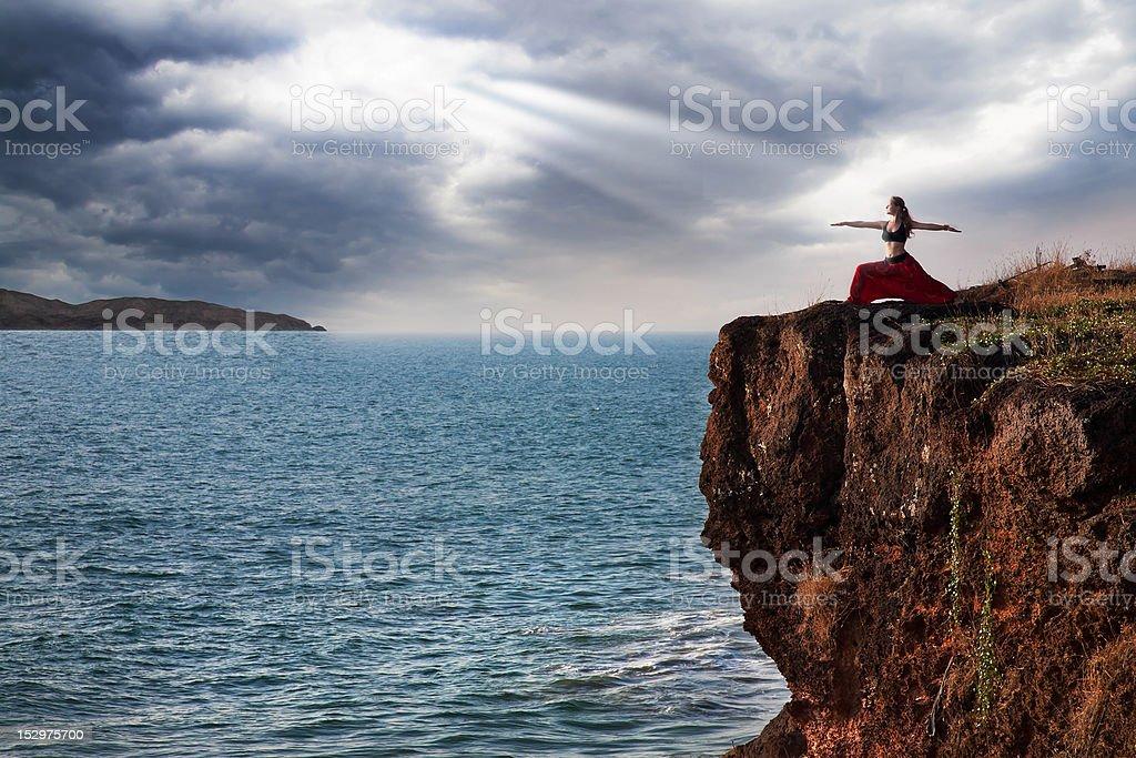 Woman doing virabhadrasana warrior yoga pose stock photo