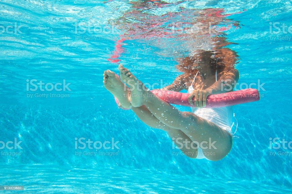 woman doing water aerobics in a pool - foto stock