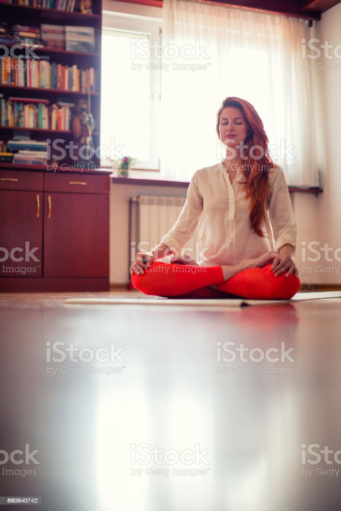 Woman doing yoga at home royalty-free stock photo