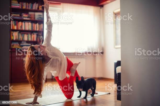 Woman doing yoga at home picture id680951066?b=1&k=6&m=680951066&s=612x612&h=ilnmcyd3pxbaghazswd3dh39razjgngzxdfgf0aek4i=
