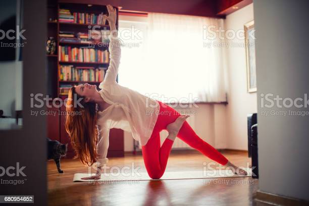 Woman doing yoga at home picture id680954652?b=1&k=6&m=680954652&s=612x612&h=d4tc2hee4unu3flgv26phfnqcb3vfc97dbrguws7pbs=