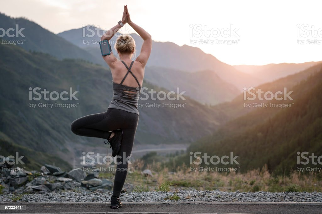 Woman Doing Yoga at sunset. Sports and recreation