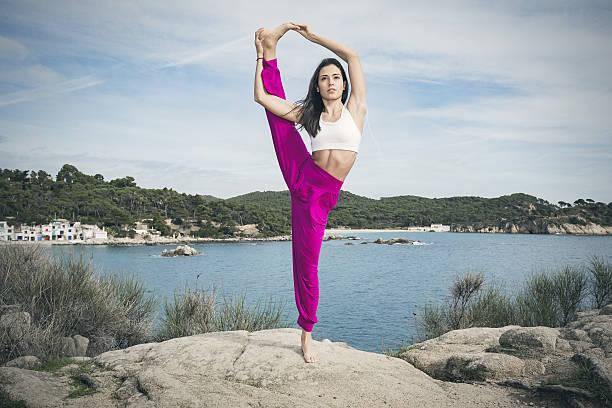 Woman doing yoga exercises at the sea stock photo