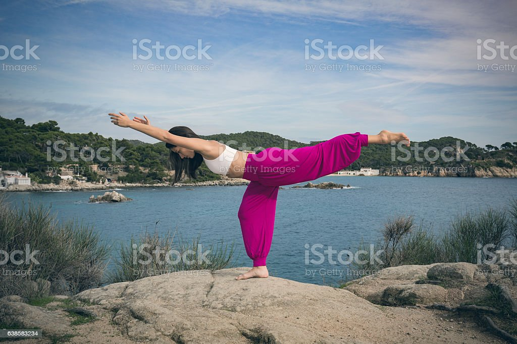 Woman Doing Yoga Exercises At The Sea Warrior 3 Pose Stock ...