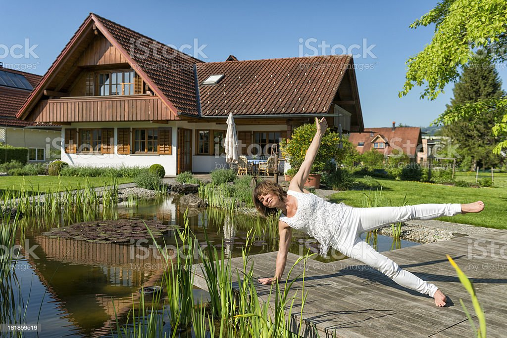 woman doing yoga exercises in the garden royalty-free stock photo