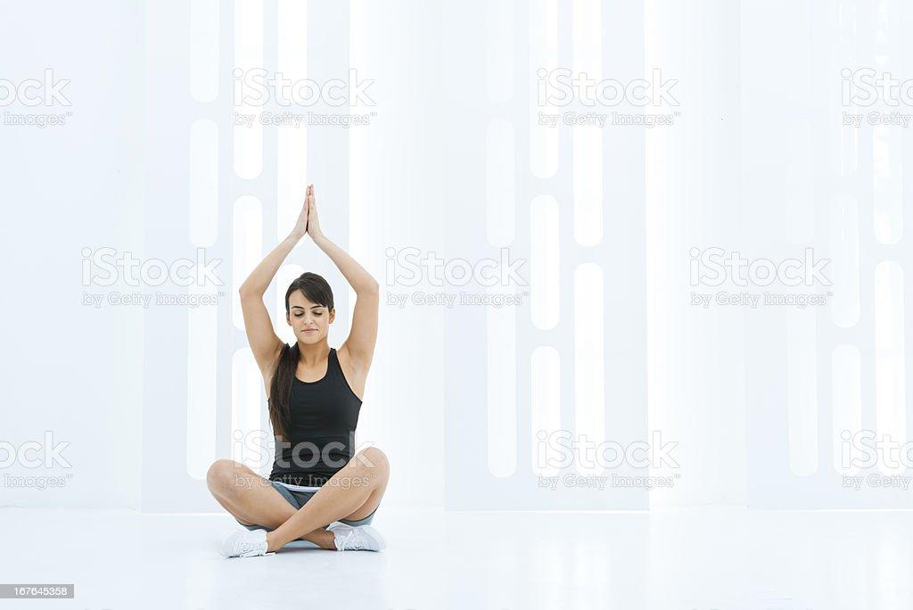 Woman doing yoga in a modern space royalty-free stock photo