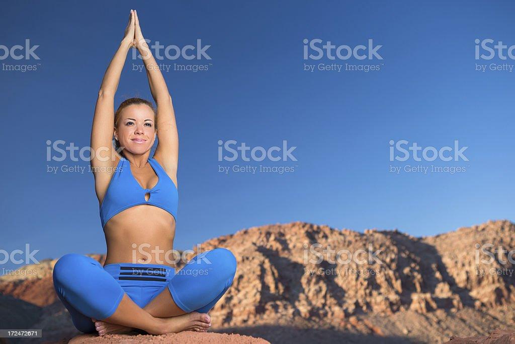 Woman doing yoga in desert