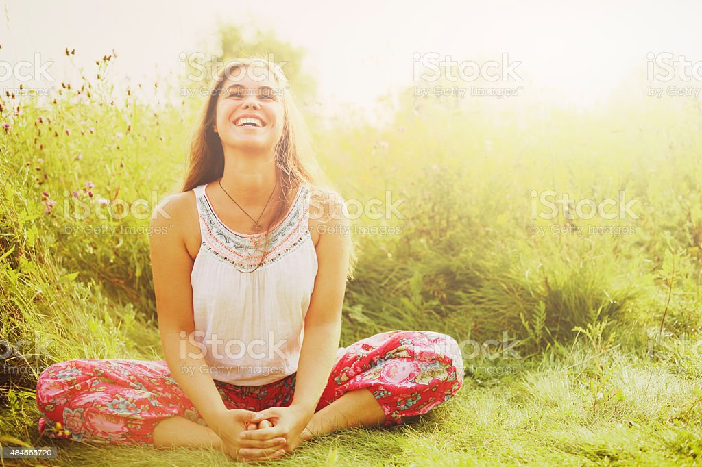 Woman doing yoga in grass. stock photo