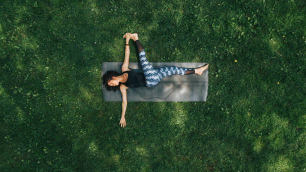 Woman doing Yoga in the Park stock photo