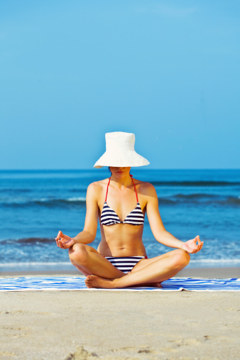 Woman Doing Yoga On The Beach Stock Photo - Download Image Now