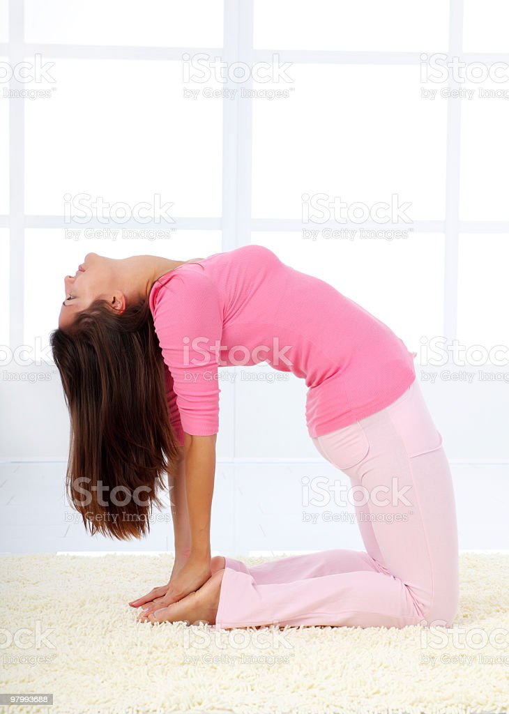 Woman doing yoga on the carpet at living room. royalty-free stock photo