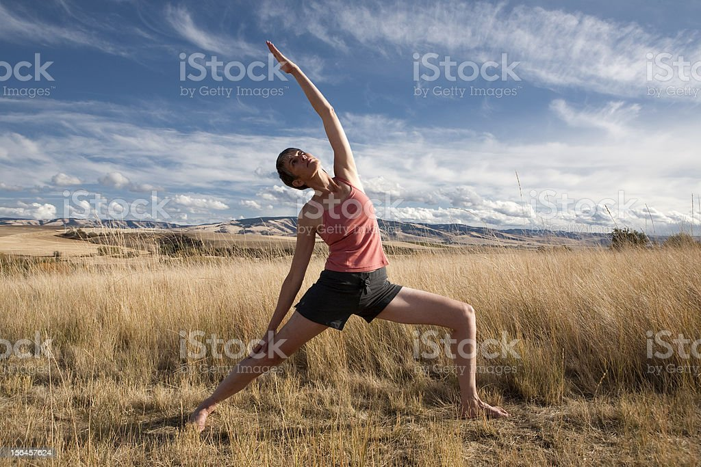 Woman doing yoga outdoors royalty-free stock photo