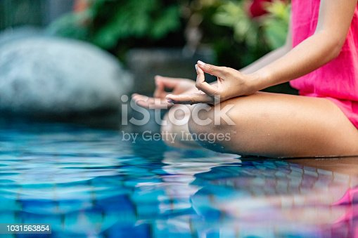 istock Woman doing yoga 1031563854