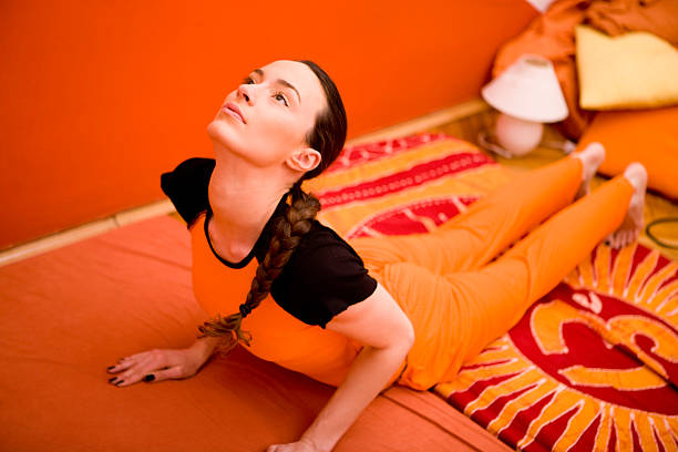 "Woman doing yoga ""Woman doing yoga, canon 1Ds mark III"" cobra pose stock pictures, royalty-free photos & images"