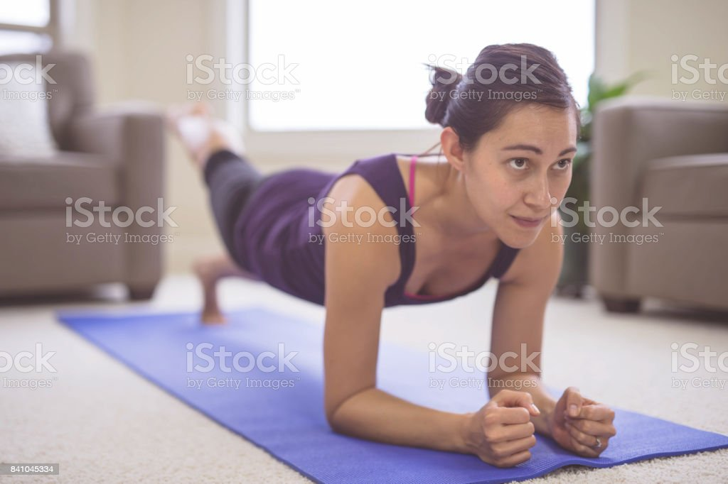 Woman doing yoga pose inside stock photo