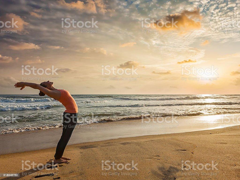Woman doing yoga Sun salutation Surya Namaskar stock photo