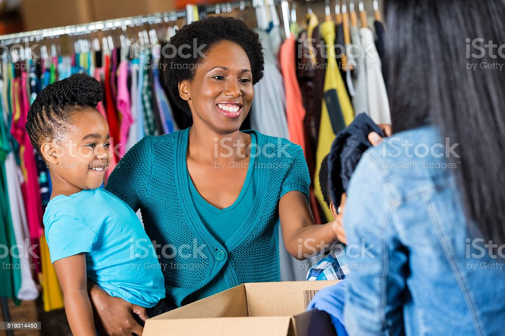 Woman donates clothing to charity stock photo