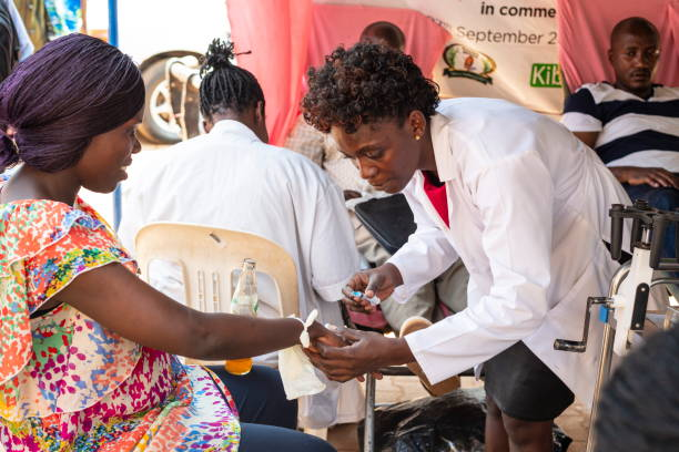 Woman donates her blood in a street point in Kampala, Uganda. stock photo