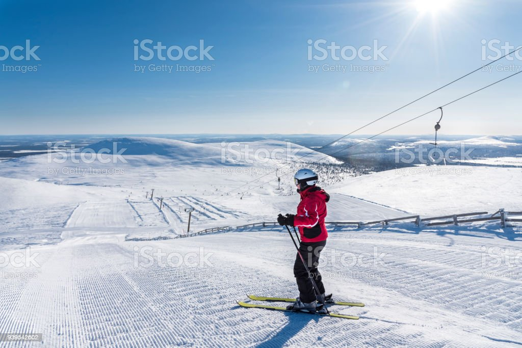 Woman downhill skiing in Lapland Finland stock photo