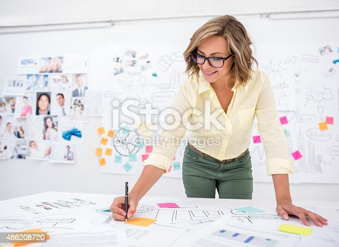 istock Woman drawing a business plan 486208720