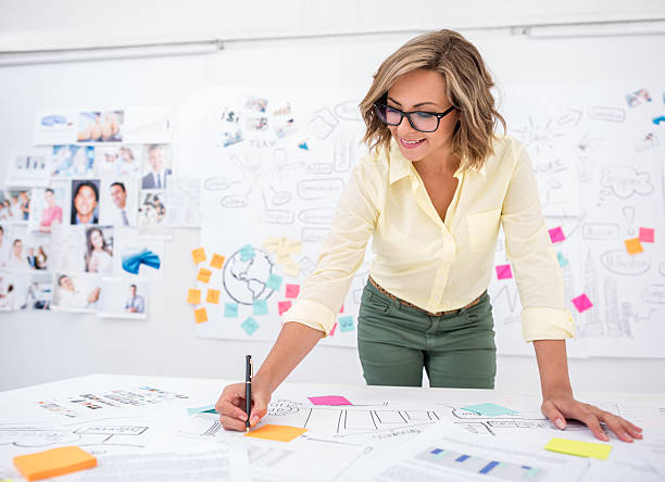 woman drawing a business plan - market research stock photos and pictures