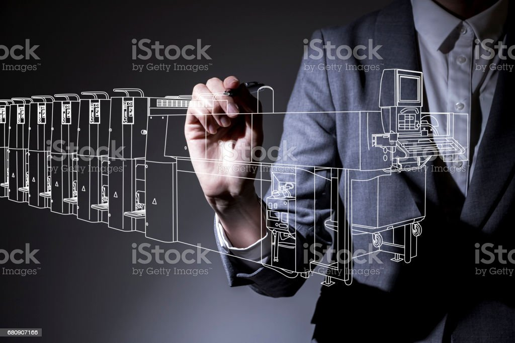 woman drawing a industrial machine line drawing in the air, industrial design concept visual stock photo