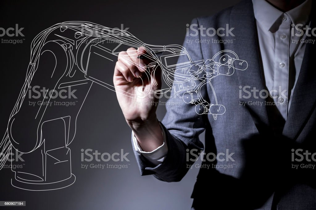 Woman drawing a robot arm in the air industrial design concept woman drawing a robot arm in the air industrial design concept visual royalty free malvernweather Choice Image