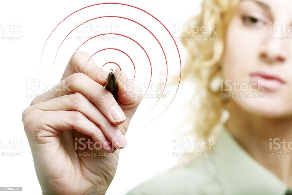 Woman drawing a target on glass royalty-free stock photo