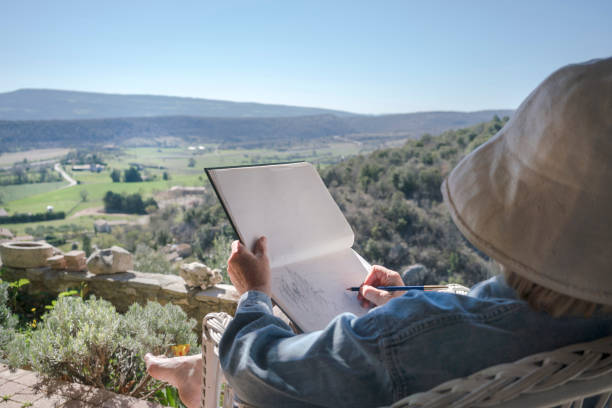 Woman drawing in Provence stock photo
