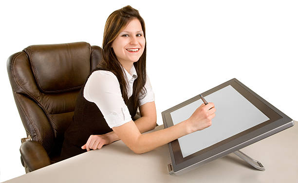 Woman Drawing on a Digital Tablet stock photo