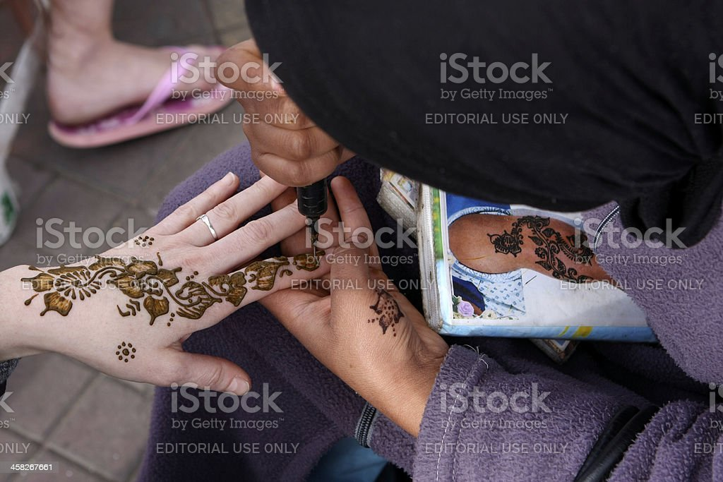 woman drawing with henna royalty-free stock photo