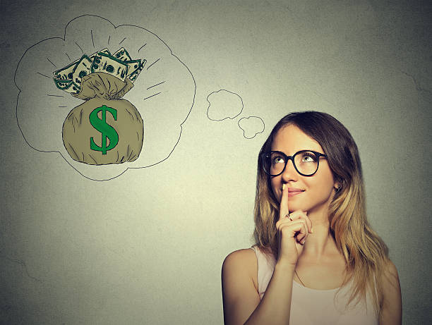 Woman dreaming of financial success Woman dreaming of financial success borrowing stock pictures, royalty-free photos & images