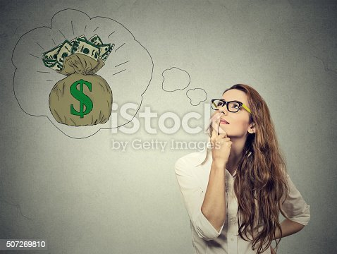 istock Woman dreaming of financial success 507269810