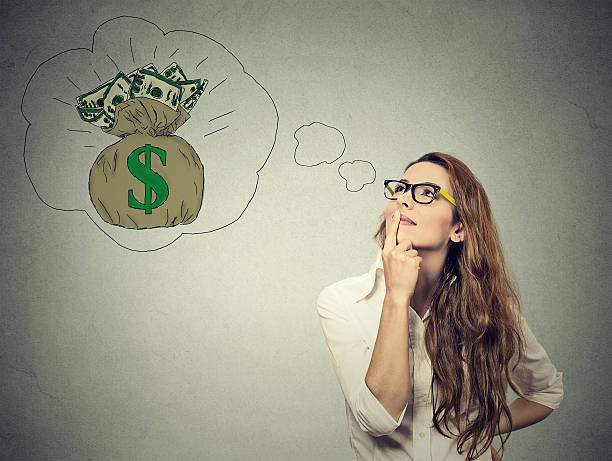 woman dreaming of financial success - day dreaming stock photos and pictures